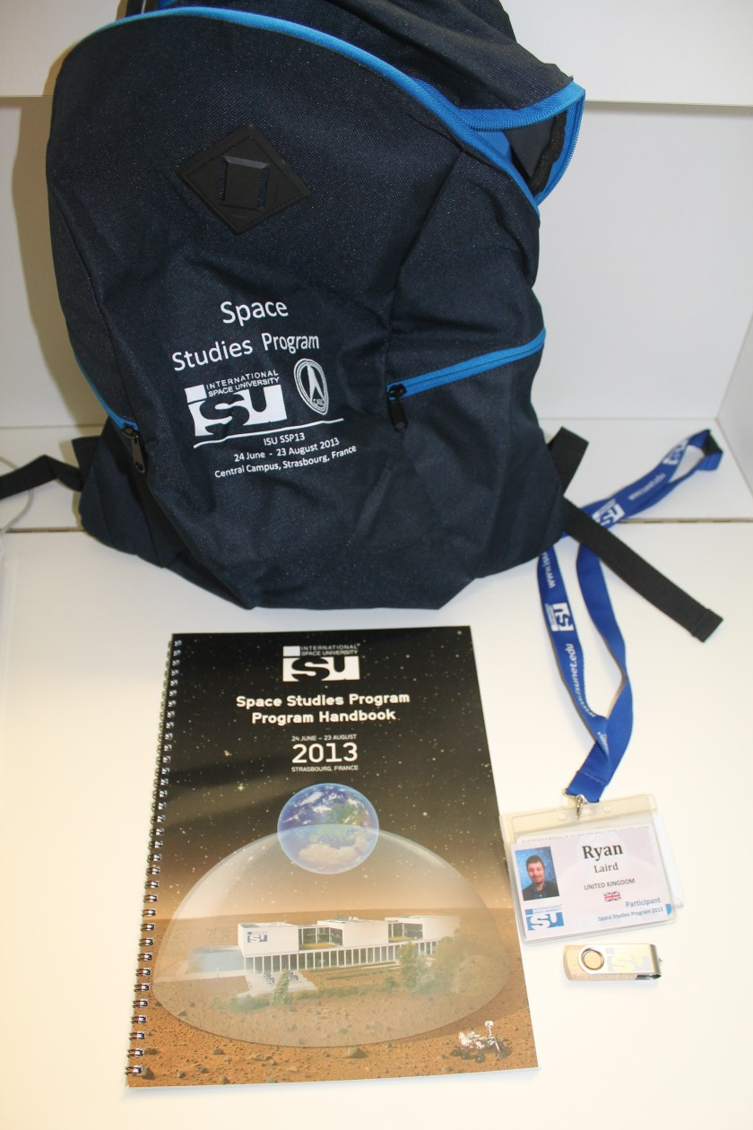 Some SSP goodies, including t-shirt (not shown), rucksack, handbook, ISU memory stick and ISU name badge, key and tram pass with lanyard.