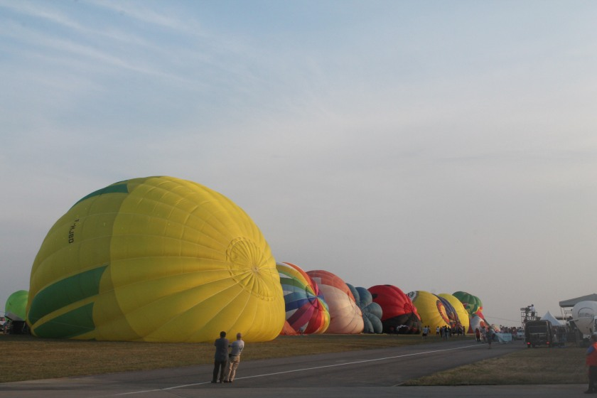 Hot air balloons just being inflated