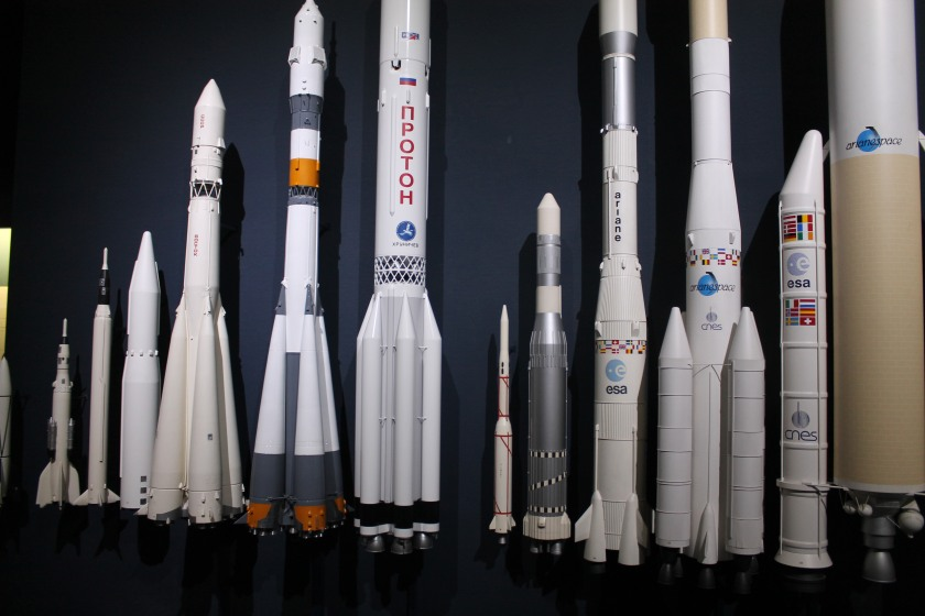 A large display of various rockets to scale at the Deutsches Museum.